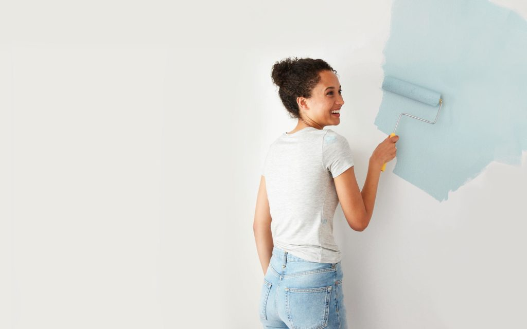 woman painting with clare paint home improvement